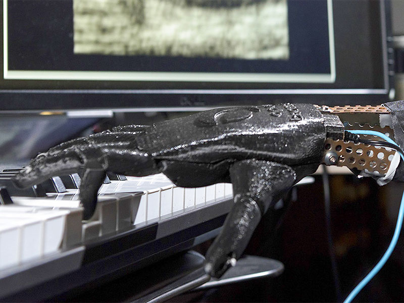 "The robotic ""Skywalker Hand"" project plays piano."