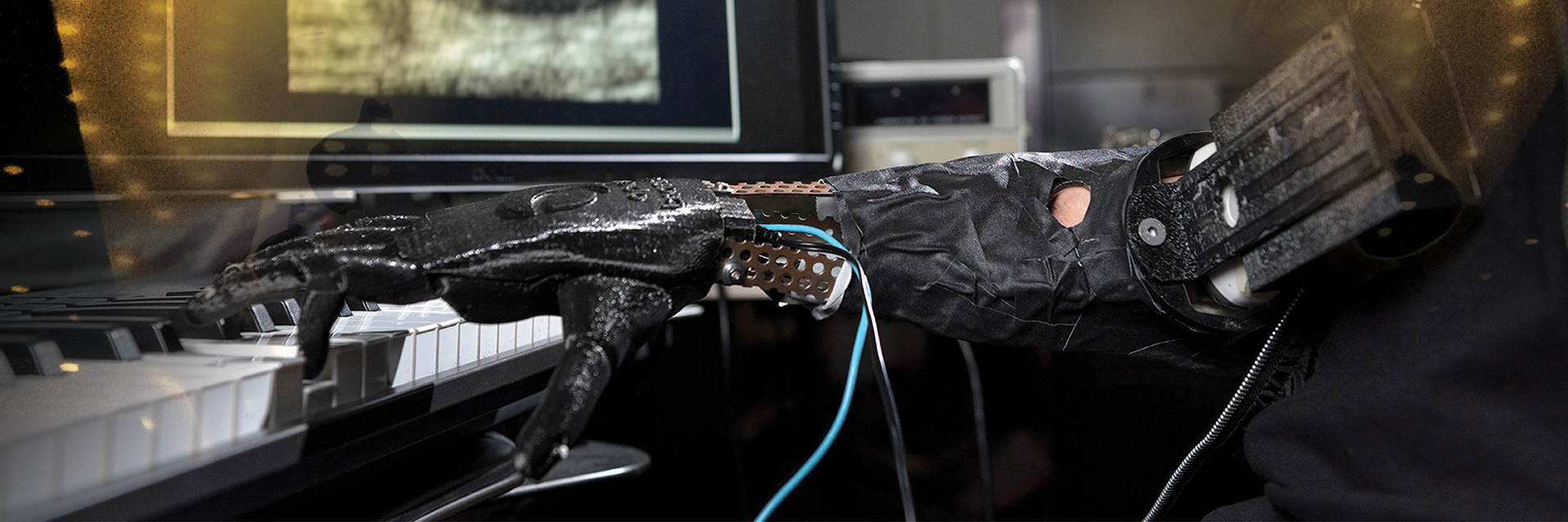 A prosthetic robotic hand playing the piano.