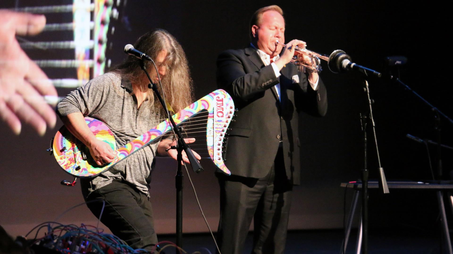 Joseph P. LoSchiavo performs with the Galaxy Electric Harp while School of Music professor Chip Crotts performs on a trumpet.