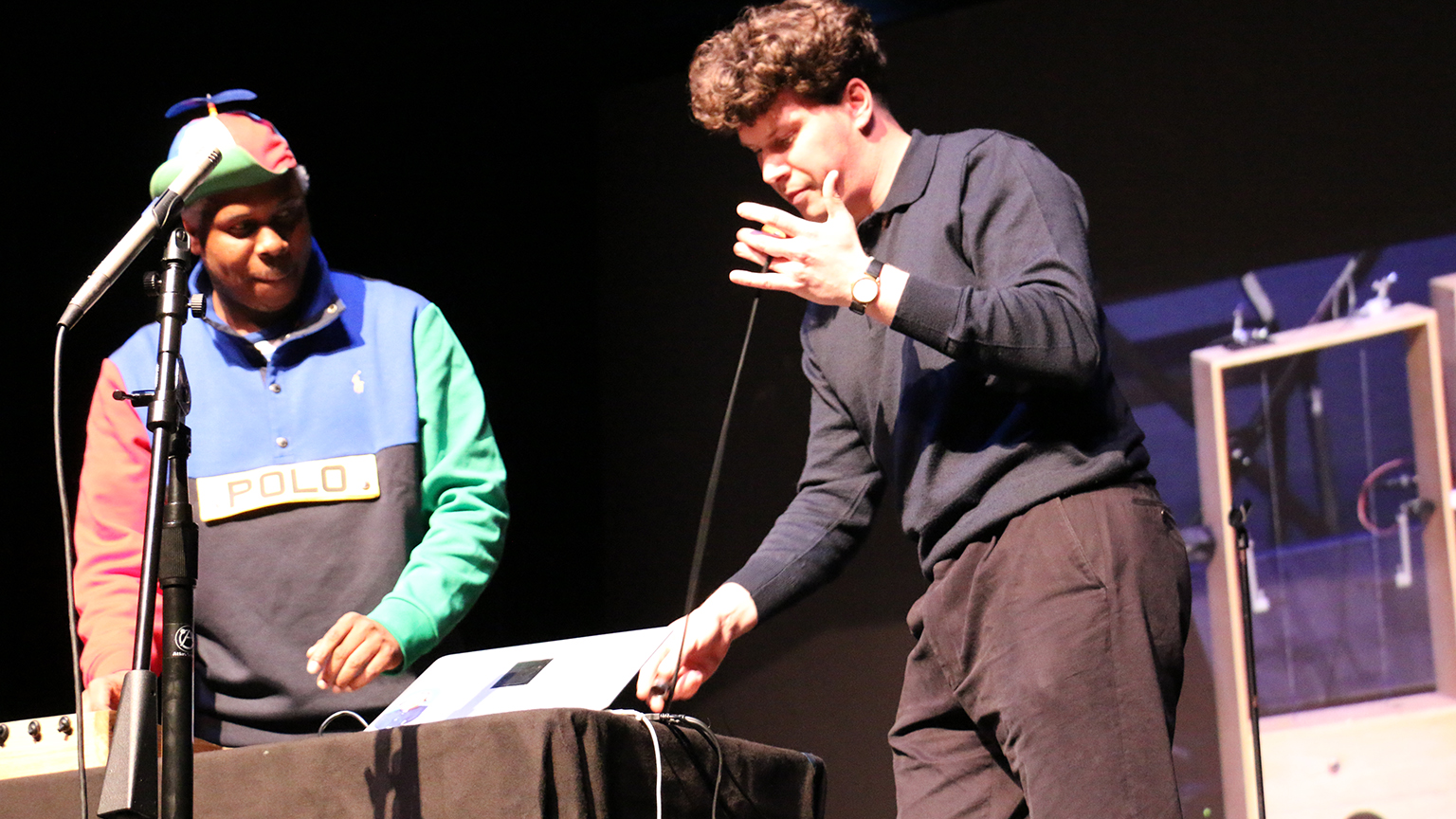 Stretchi creator Hugh Aynsley demonstrates his instrument on stage with collaborator Shannon Ladson.