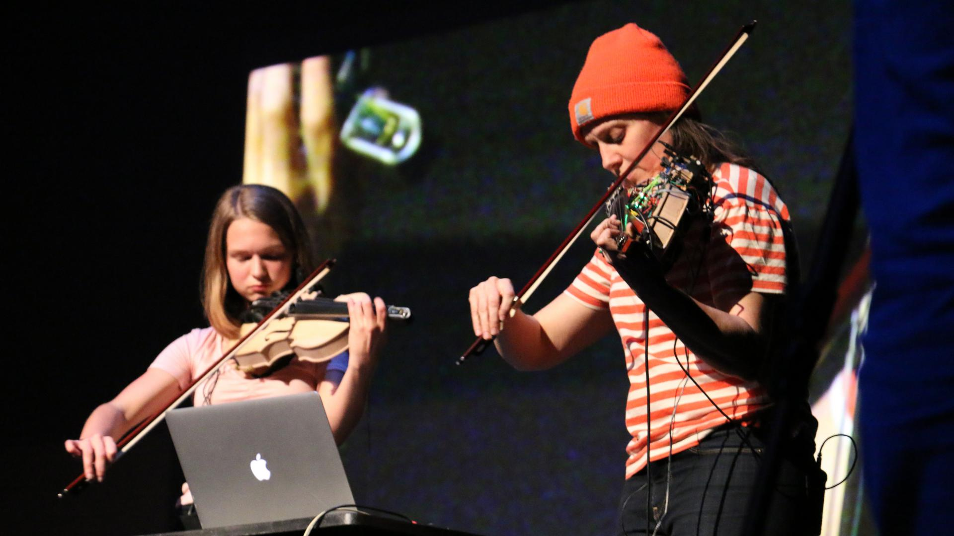 Svampolin creator Laurel S Purdue performs with the Svampolin on stage with BSMT student Ally Stout, who uses a normal violin.